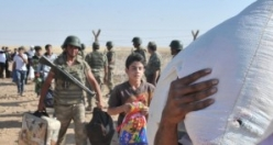 Türk Askerinden Suriyeli Sığınmacılara Yardım Eli